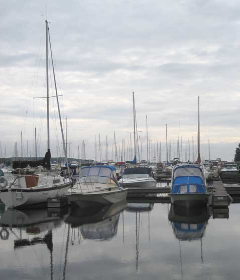 Photo: Bayport Yacht Centre docks with overcast sky and and dead calm.