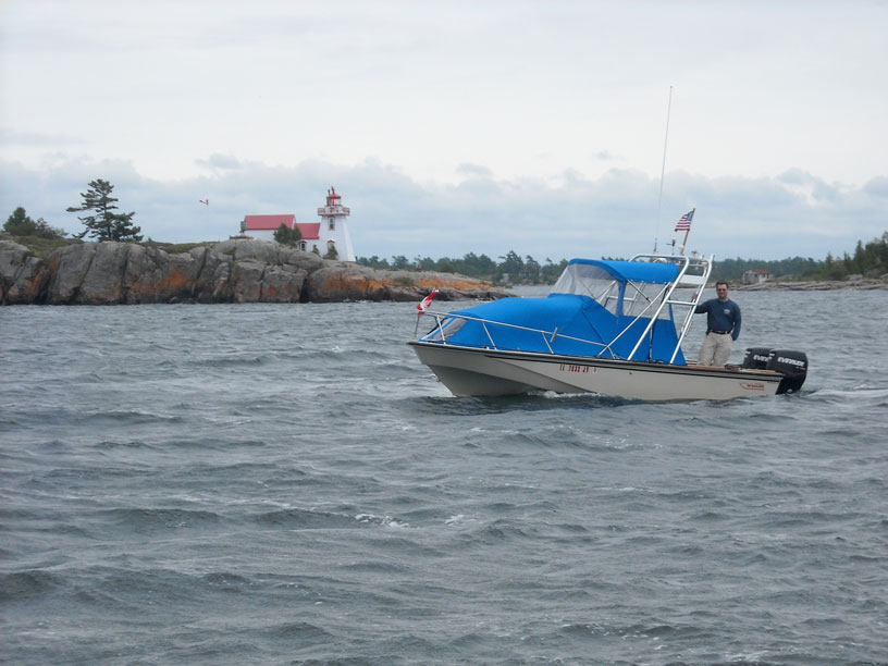 Photo: Dave Buckalew aboard GAMBLER, near Pointe Au Baril, Ontario.