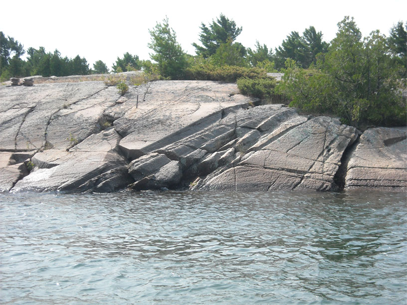 Photo: Shoreline rock with glacial ruts, Byng Inlet, Ontario.