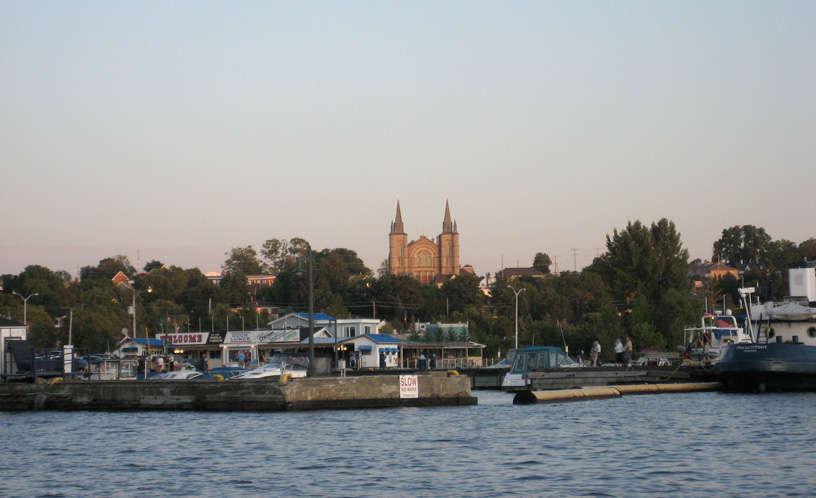 Photo: Dock and church at Penetanguishene, Ontario, seen from the harbor.