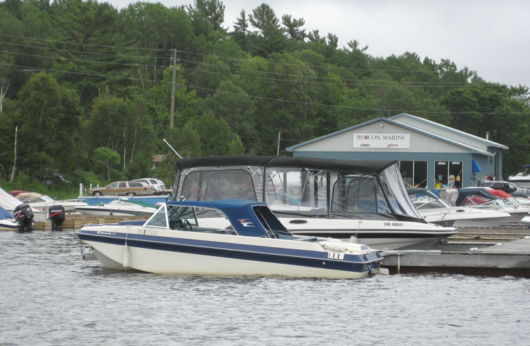 Photo: Older OMC sterndrive runabout at Beacon Marine in Pte. Au Baril Station, Ontario.