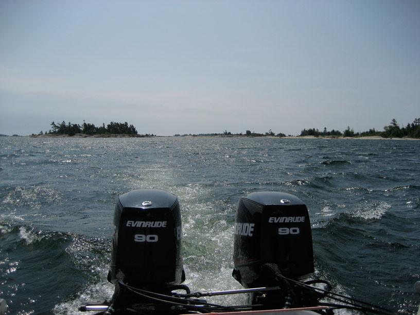 Photo: Twin E-TEC 90-HP outboards