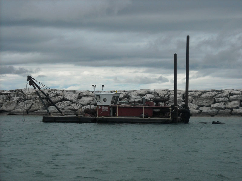 Dredge in Leland Harbor