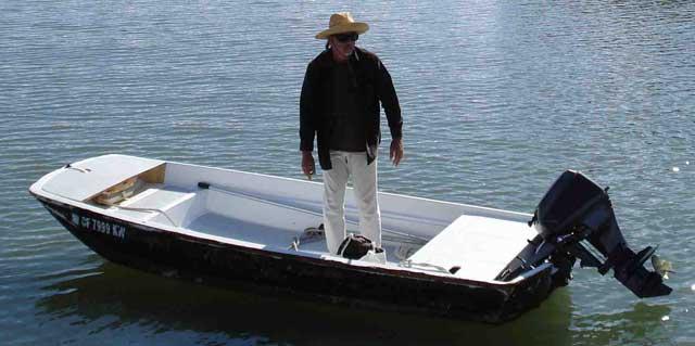 Photo: Boston Whaler 13-foot boat with dark hull