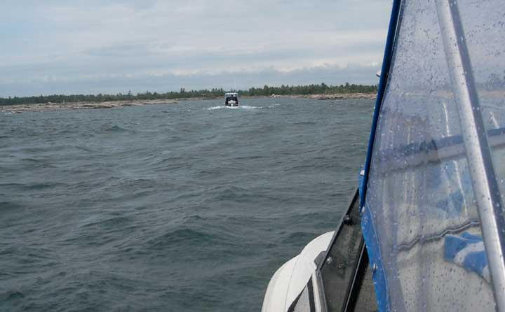 Photo: Boston Whaler boats entering HANGDOG REEF from Georgian Bay in stormy weather.