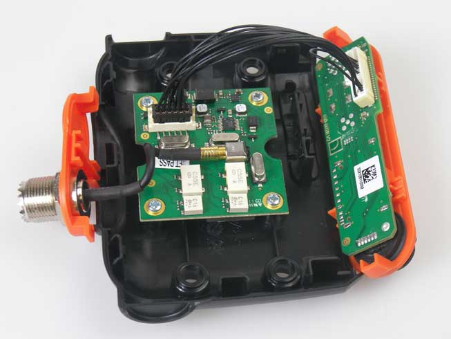 View of em-trak R100 AIS receiver with case opened to show internal components.