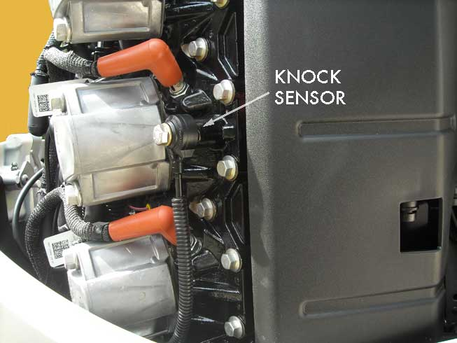 Photo: location of knock sensor on 3.3-liter V6 E-TEC engine.