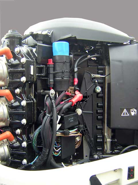 [Photo: Evinrude 225-HP E-TEC Outboard starboard side with cowling and shroud removed.]