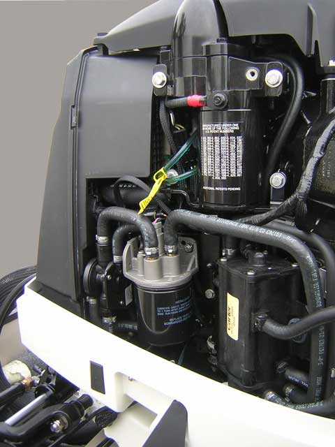 [Photo: Evinrude 225-HP E-TEC Outboard close-up port forward side of engine.]