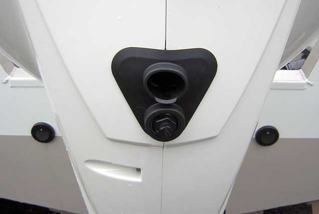 [Photo: Evinrude 225-HP E-TEC Outboard close-up flush port and tell tale.]