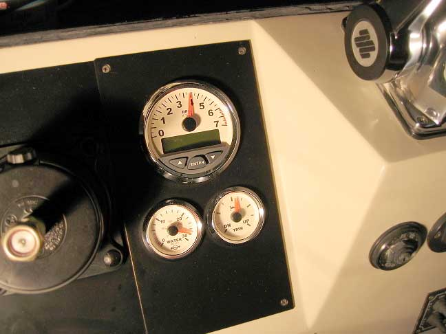 Photo: Boston Whaler console with Evinrude I-Command Tachometer, Water Pressure, and Trim gauges