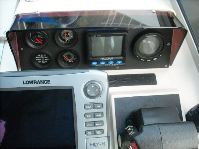 Lowrance HDS-8 on Boston Whaler REVENGE 22 helm, elevated view.