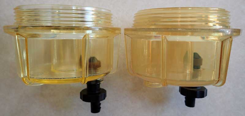Photo: two RACOR filter clear bowls.