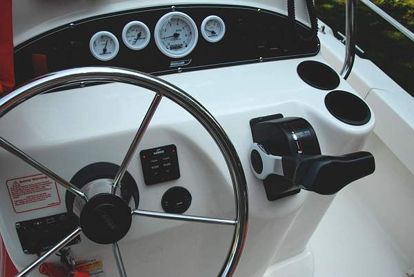 Photo: Trim tab controls installation on helm console of Boston Whaler 190 NANTUCKET.