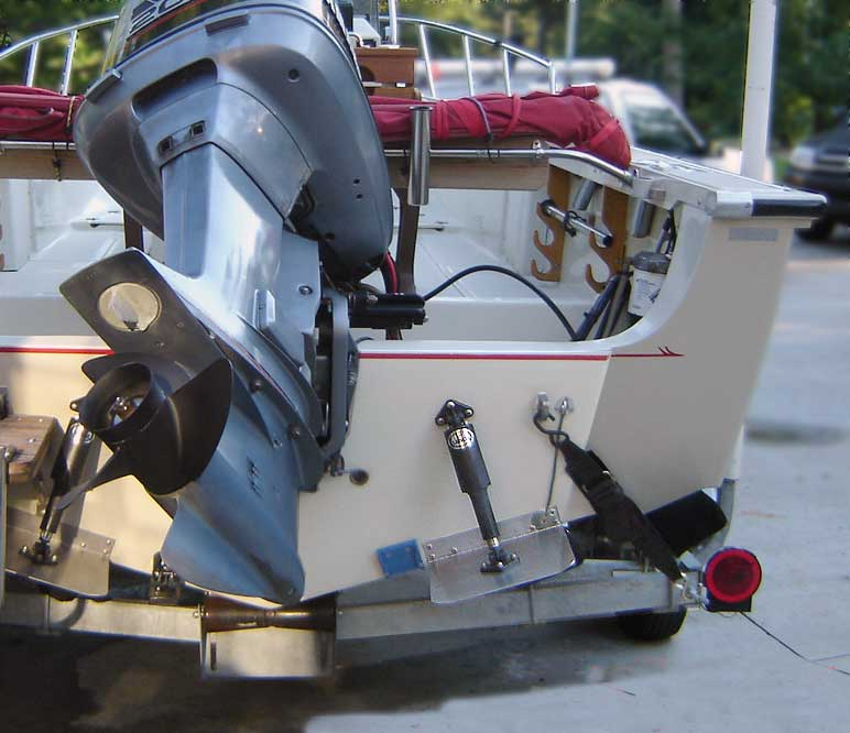 Photo: Stern view of Boston Whaler OUTRAGE 20 hull showing trim tabs mounted on raised portion of transom.