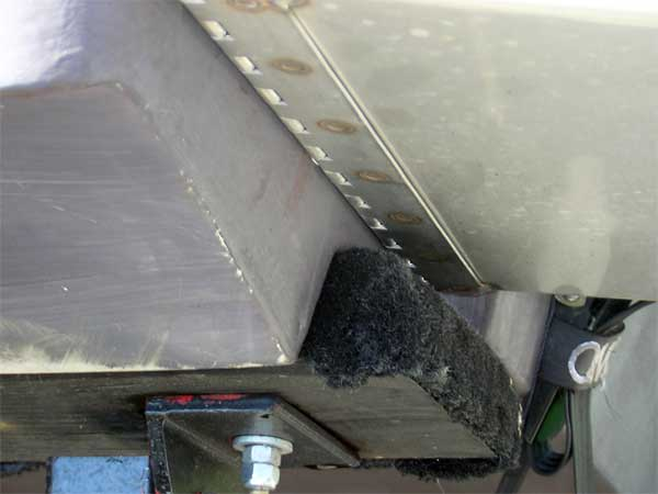 Photo: Tab installation showing change in hull bottom beneath tab surface.