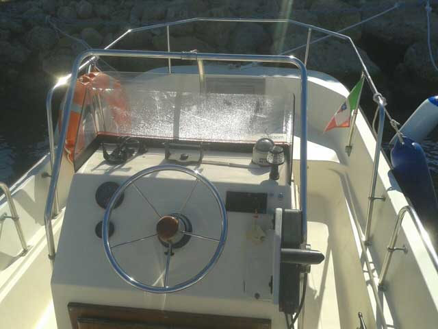 View of console of 17-foot center console boat that resembles a Boston Whaler MONTAUK.