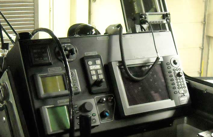 Helm position of USCG 45-foot boat showing Motorola XLT-5000 radio.