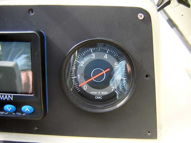Photo: Close-up of new panel showing good alignment to existing holes in dashboard.