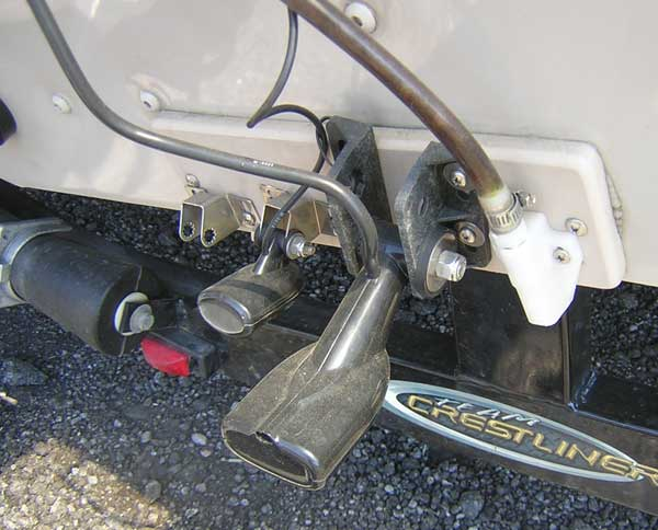PHOTO: Transom of fishing boat showing plastic plate installed for purpose of mounting transducers.